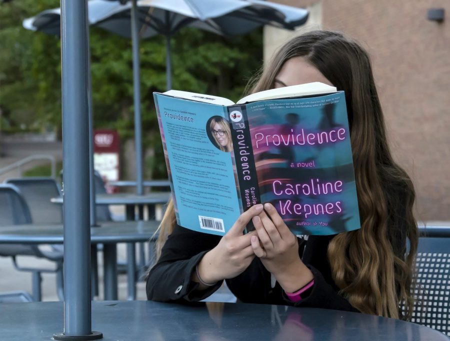 "Staff writer, Rana Schenke, reads ""Providence"" by Caroline Kepnes, Thursday, Oct. 11, 2018. (Carson VanBuskirk 