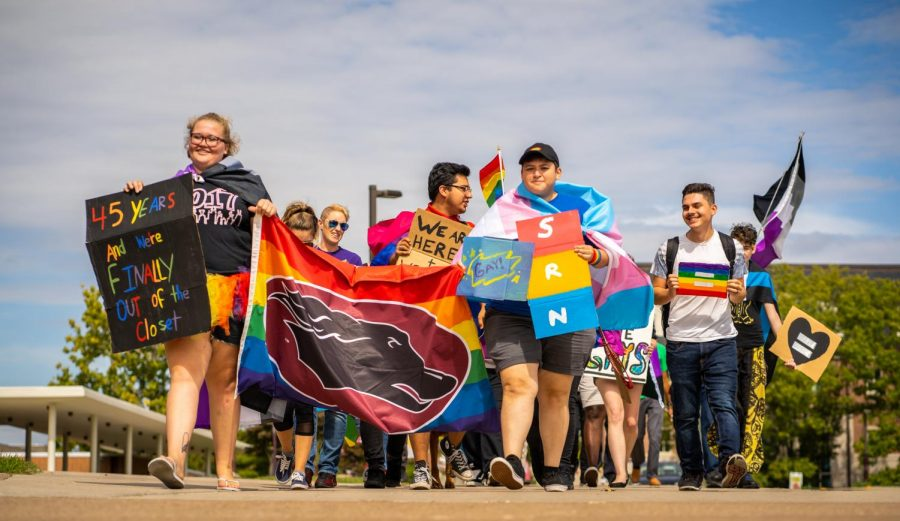 Members of the Saluki Rainbow Network walk around campus Monday, Oct. 1, 2018. The RSO put on the LGBTQ+ Pride Walk to spread love and acceptance across the campus community. (Dillon Gilliland | Daily Egyptian)