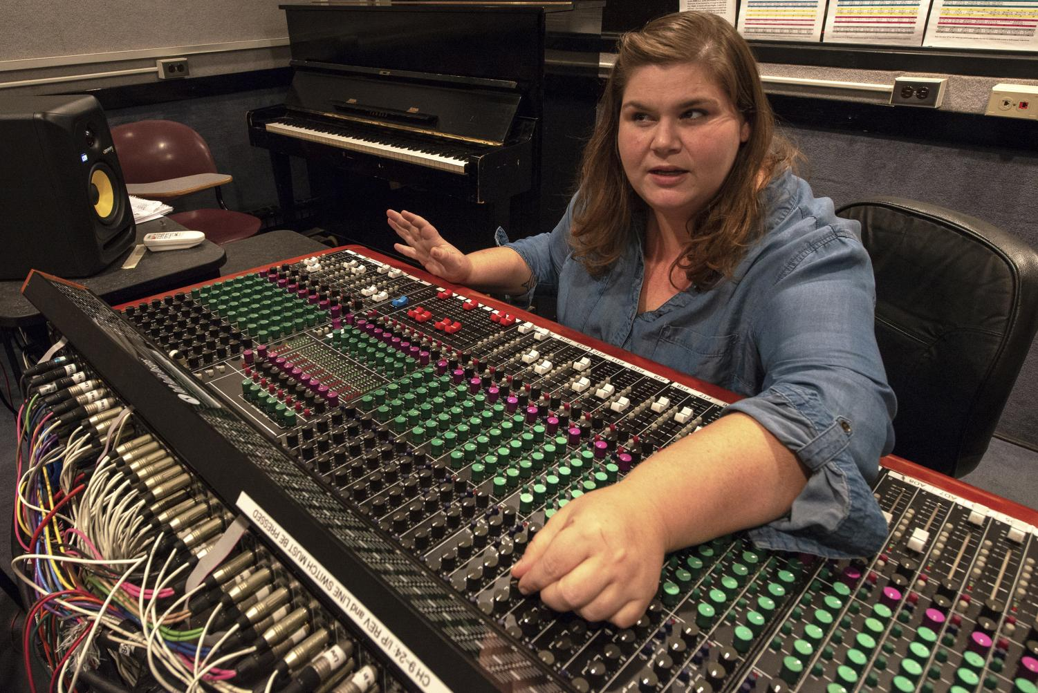 Jenny Johnson, a lecturer in the Radio, Television, and Digital Media department of SIU operates a soundboard. Oct. 17, 2018. (Chase Jordan | @chasejordande)