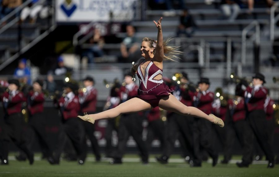 Jazmin Randazzo, a junior studying biological sciences, leaps during halftime of the Salukis' 24-21 loss against the Indiana State Sycamores at Saluki Stadium, Saturday, Oct. 20, 2018. (Isabel Miller   @IsabelMillerDE)