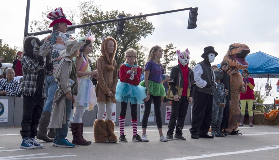 Best costume contestants line up during The Great Carbondale Pumpkin Race to show off their costumes on Saturday, Oct. 27, 2018, at Carbondale's Halloween. (Carson VanBuskirk | @carsonvanbDE)