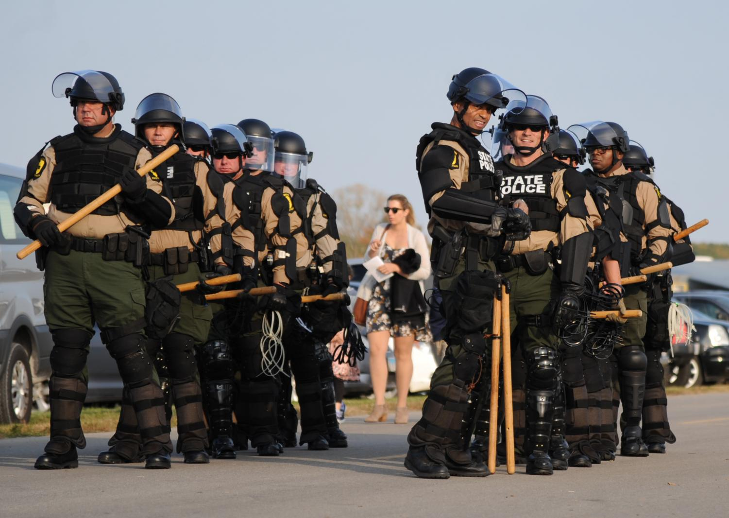 State+police+in+tactical+gear+line+up+in+preparation+for+the+approaching+protesters%2C+during+the+MAGA+Rally%2C+Saturday%2C+Oct.+27%2C+2018%2C+at+the+Southern+Illinois+Airport+in+Murphysboro.+%28Mary+Barnhart+%7C+%40MaryBarnhartDE%29