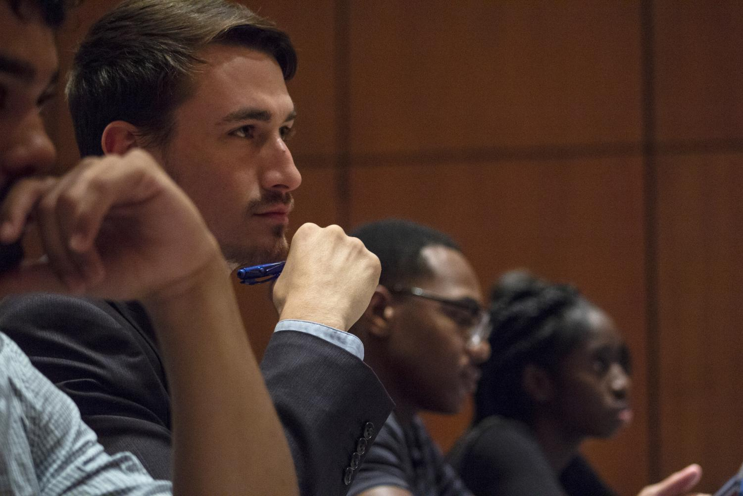 Trey Hentis, a senior majoring in mechanical engineering, listens during an undergraduate student government meeting, Tuesday, Oct. 30, 2018, inside the Student Center. (Isabel Miller | @IsabelMillerDE)