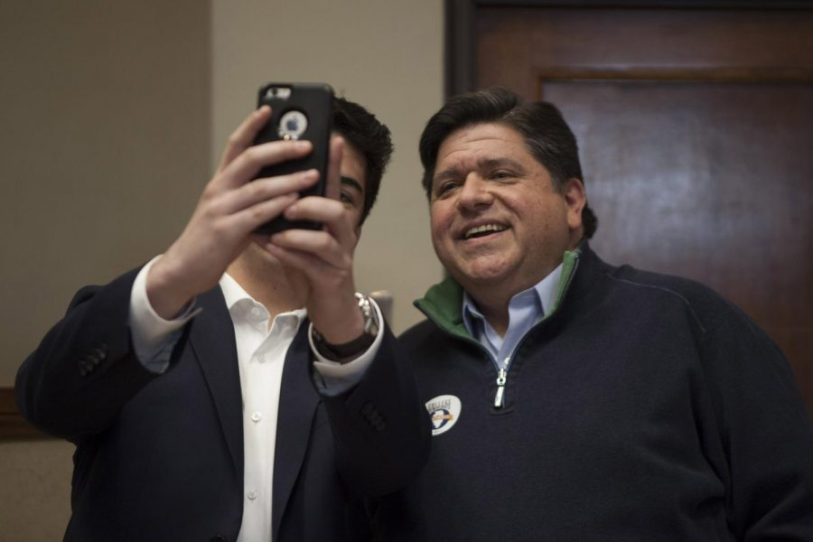 JB+Pritzker+takes+a+selfie+during+a+College+Democrats+conference+at+the+University+of+Illinois%2C+April+21%2C+2018.+%28Isabel+Miller+%7C+%40IsabelMillerDE%29
