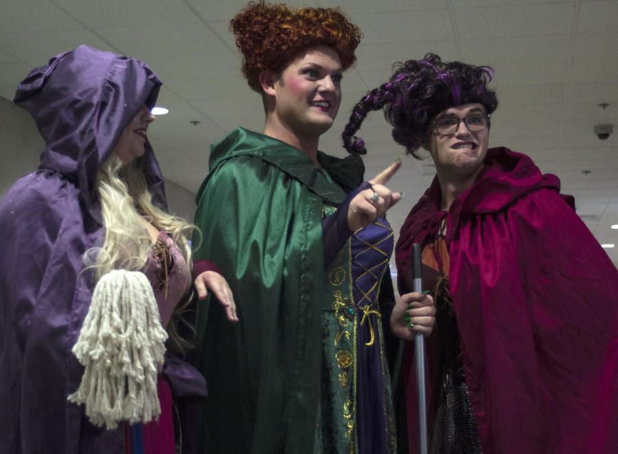 """Mortuary Science Seniors Katie Eatmon, Timothy Brueggemann, and Connor Ashlock share a laugh while dressed as the three witches from the movie """"Hocus Pocus"""", Wednesday, Oct. 31, 2018, at the Student Center. (Nick Knappenburger 
