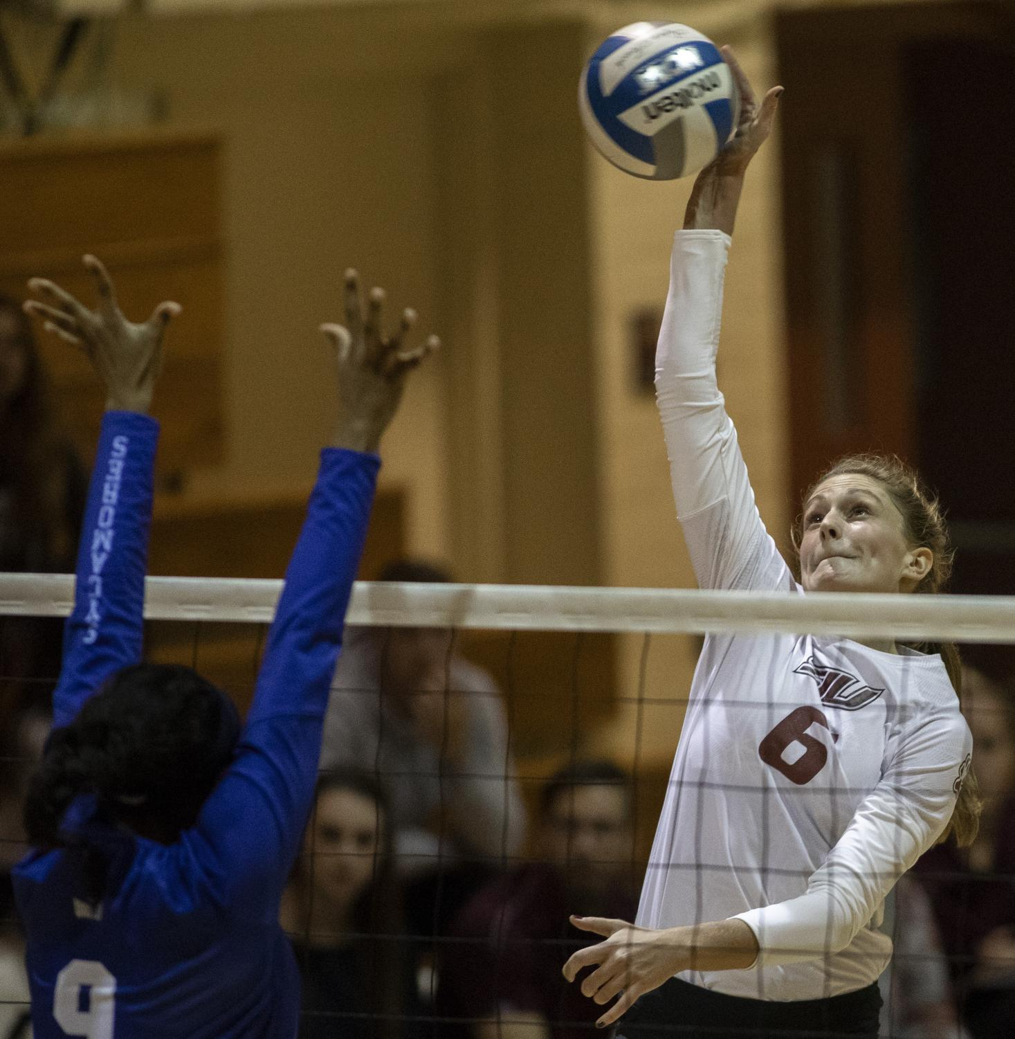 Junior opposite hitter, Emma Baalman, spikes the ball, Friday, Nov. 2, 2018, during the Saluki's 3-1 win againt the Indiana Sycamores, at Davies Gym. (Isabel Miller | @IsabelMillerDE)