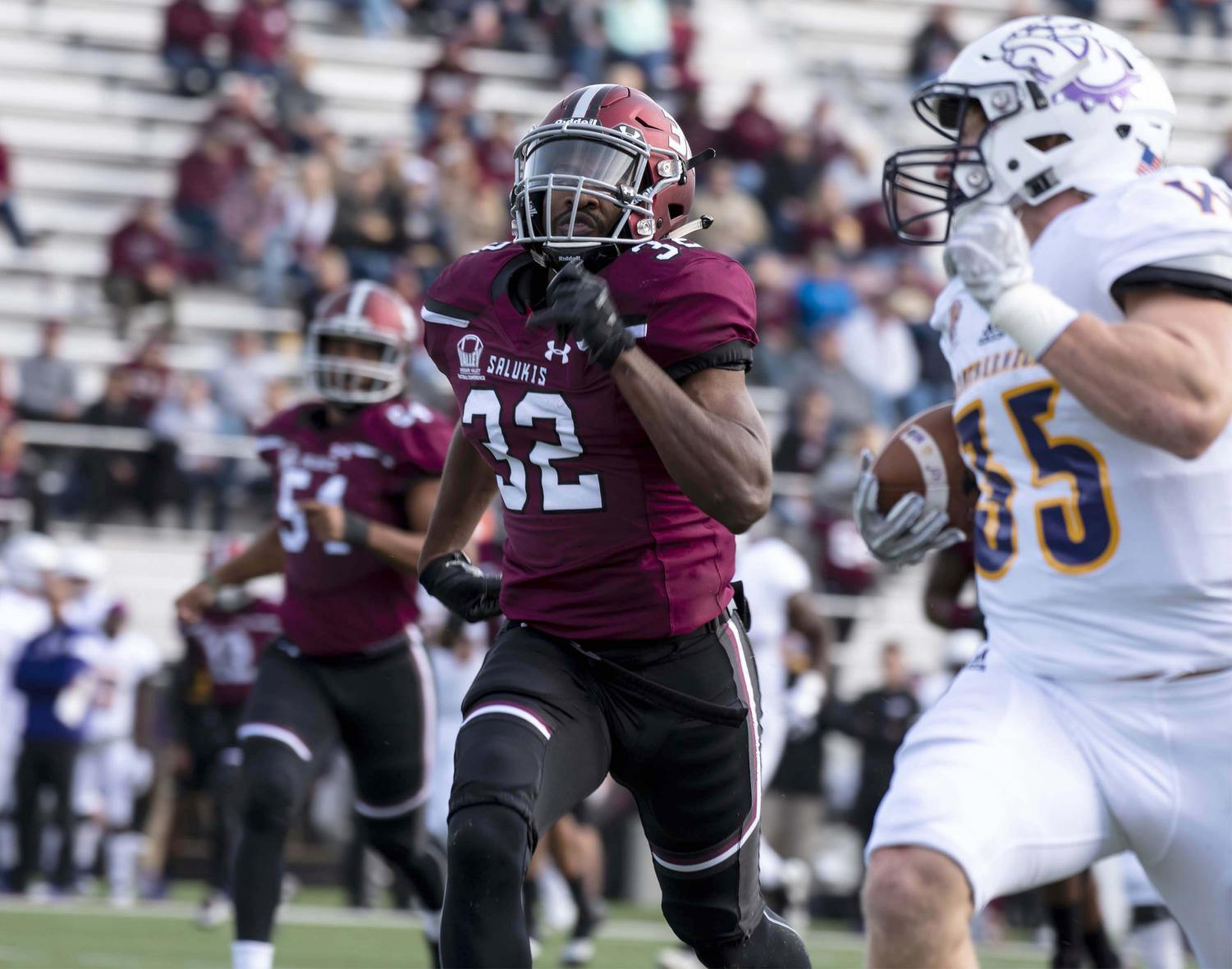 Senior safety, Joe Patterson, of Chicago, runs along side Leatherneck's running back, Larry Harleston, of Racine, Wis.,Saturday, Nov. 3, 2018, during the Salukis' 34-31 loss against Western Illinois University at the Saluki Stadium. (Allie Tiller | @allietiller_de)
