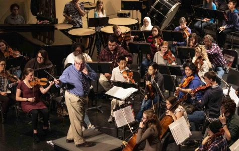 Edward Benyas, professor of oboe and conducting, conducts the Southern Illinois University Symphony Orchestra as they prepare for their Veteran's Day concert during practice at the Shryock Auditorium, Sunday, Nov. 11, 2018. (Allie Tiller | @allietiller_de)