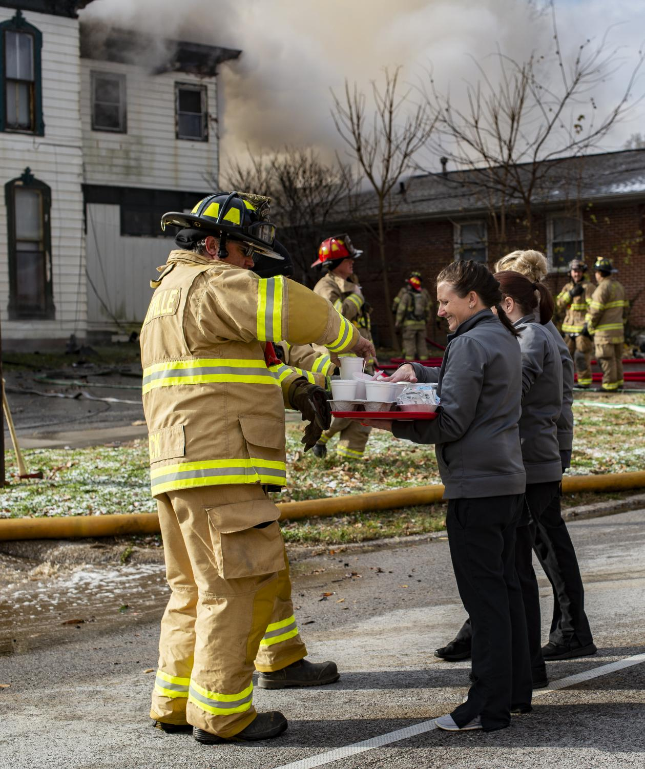 SIH+employees+give+coffee+and+hot+chocolate+to+firefighters+on+the+corner+of+Poplar+and+route+13%2C+Tuesday%2C+Nov.+13%2C+2018.+The+Fire+Department+has+not+yet+released+a+statement.+The+house+was+built+in+1881.+%28Isabel+Miller+%7C+%40IsabelMillerDE%29