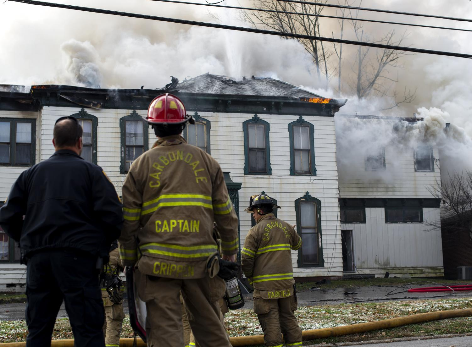 Firefighters put out fire on the corner of Poplar and Route 13, Tuesday, Nov. 13, 2018. The Fire Department has not yet released a statement. The house is regarded as the 'oldest' in Carbondale. (Isabel Miller | @IsabelMillerDE)