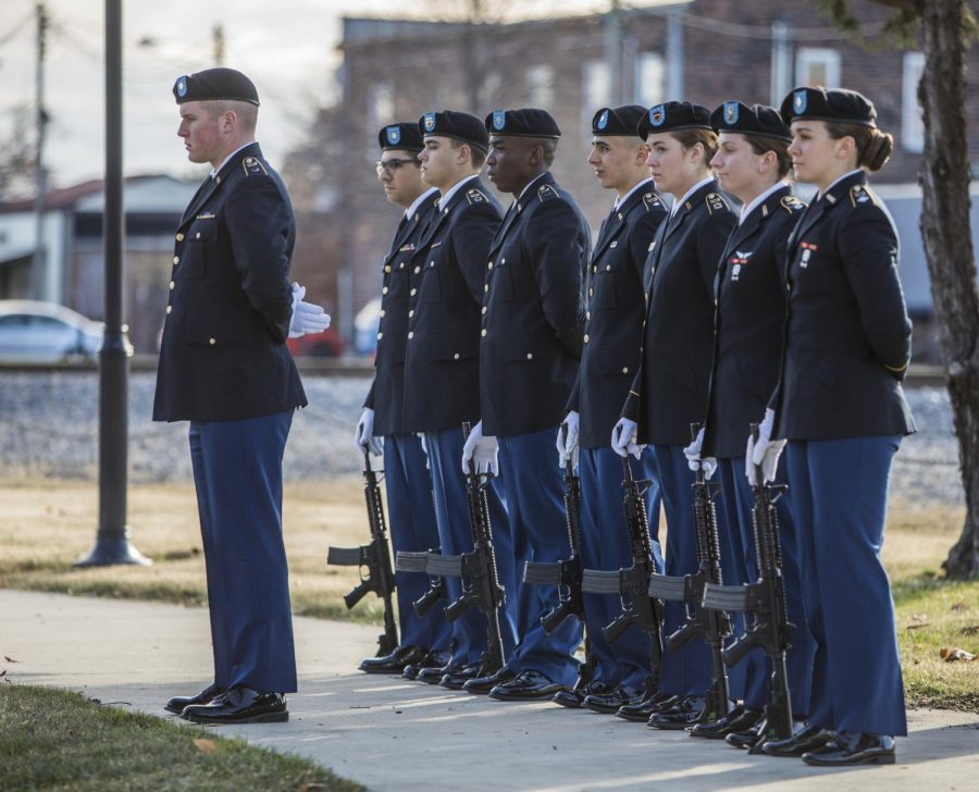 The rifle team lead by Cadet Logan Davis, stand waiting for the three-volley salute, Saturday, Nov. 11, 2018, during the Carbondale Veterans Day Ceremony, at the Veterans Memorial Plaza, in Carbondale. (Corrin Hunt   @CorrinIHunt)