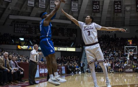 SIU graduate student Marcus Bartley, attempts to block a shot from Jordan Goodwin, at the SIU vs. SLU basketball game on Wednesday, Dec. 5, 2018. (Carson VanBuskirk | @carsonvanbDE)