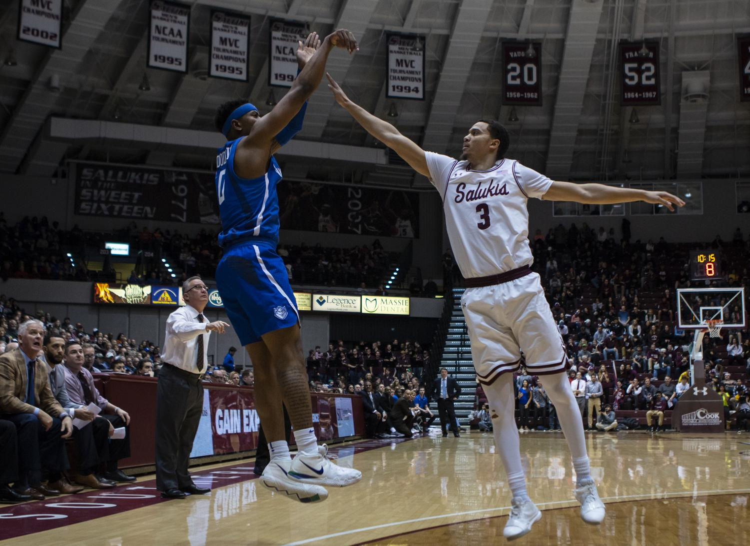 SIU graduate student Marcus Bartley, attempts to block a shot from Jordan Goodwin, at the SIU vs. SLU basketball game on Wednesday, Dec. 5, 2018. (Carson VanBuskirk | @carsonvanbDE)