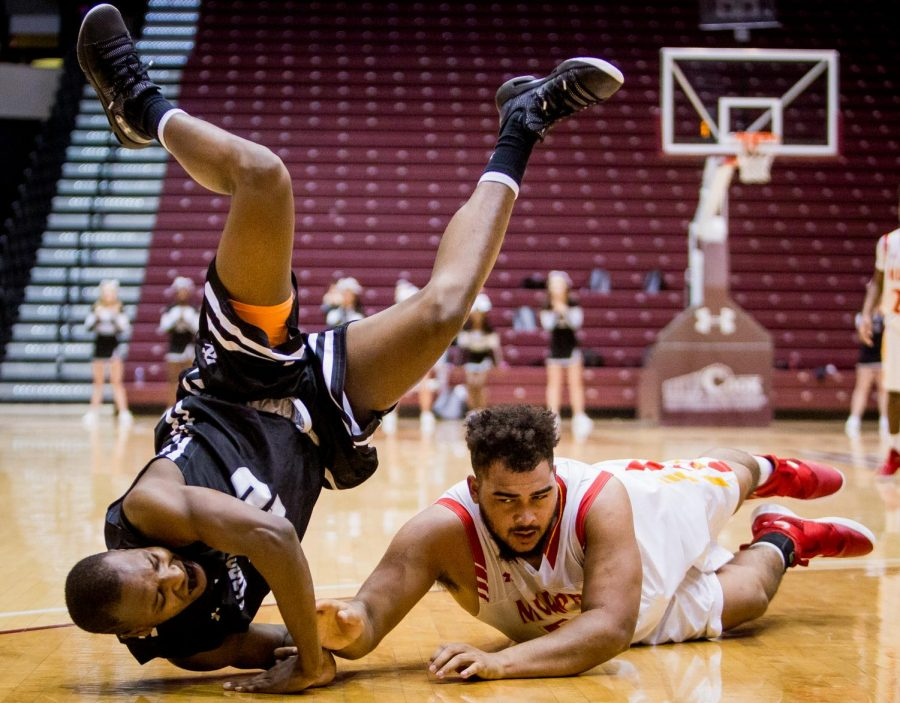 Carbondale senior Thomas Anderson takes a tumble while trying to reach for the ball past Murphysboro senior Maurice Valliant on Saturday, Dec. 29, 2018, during the Carbondale Holiday Tournament 5th place game at SIU Arena in Carbondale, Illinois. The Carbondale Terriers beat out the Murphysboro Red Devils, 43-37.
