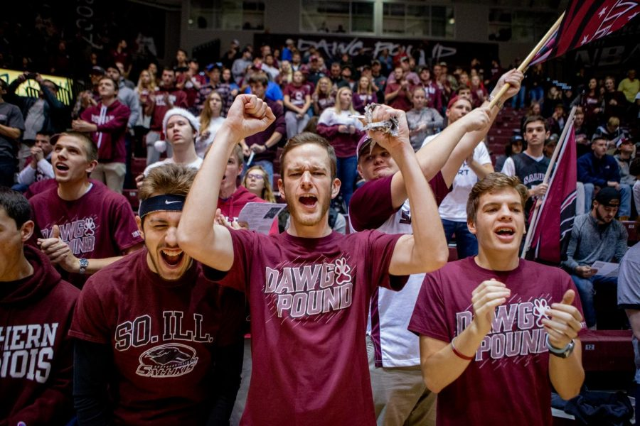Adam+Vogel%2C+a+junior+studying+mechanical+engineering+from+Bloomington%2C+center%2C+cheer+on+the+Dawgs+on+Wednesday%2C+December+12%2C+2018+during+the+first+half+of+the+Salukis+matchup+against+the+Murray+State+Racers.++