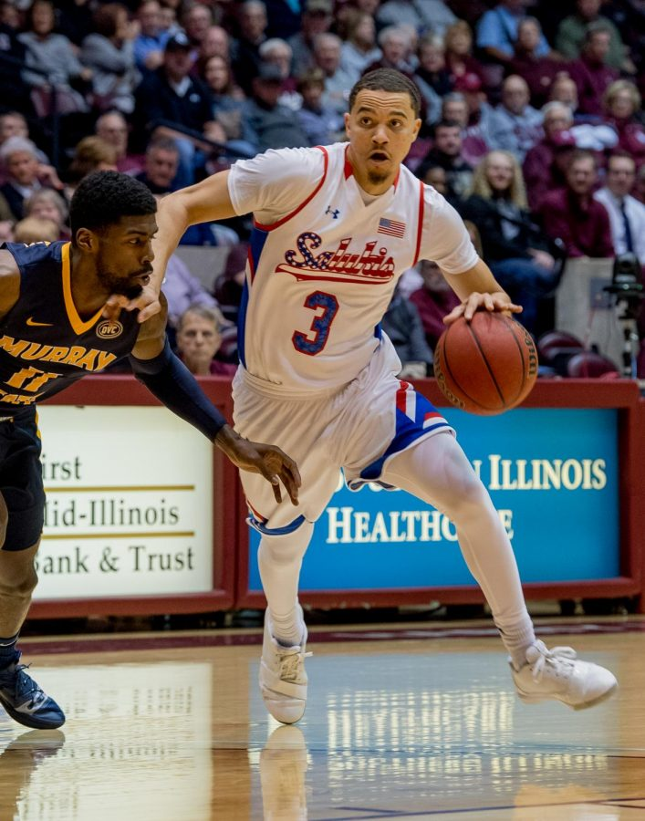 Southern Illinois guard Marcus Bartley attempts to get the ball past Murray State Racers guard Shaq Buchanan on Wednesday, December 12, 2018 during the first half of the Salukis matchup against the Murray State Racers.