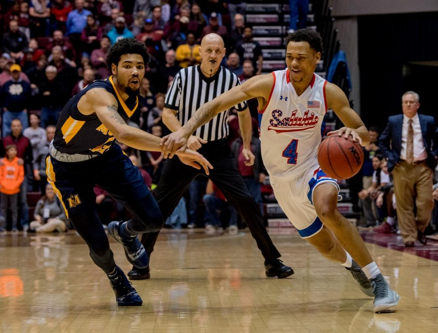 Southern Illinois junior guard Eric McGill drives the ball up the court on Wednesday, December 12, 2018 during the first half of the Salukis matchup against the Murray State Racers.