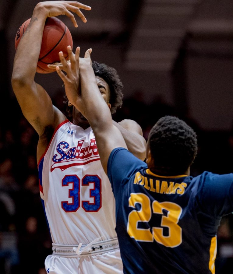 Murray State Racers forward KJ Williams attempts to get the ball from Southern Illinois sophomore center Kavion Pippen on Wednesday, December 12, 2018 during the first half of the Salukis matchup against the Murray State Racers.