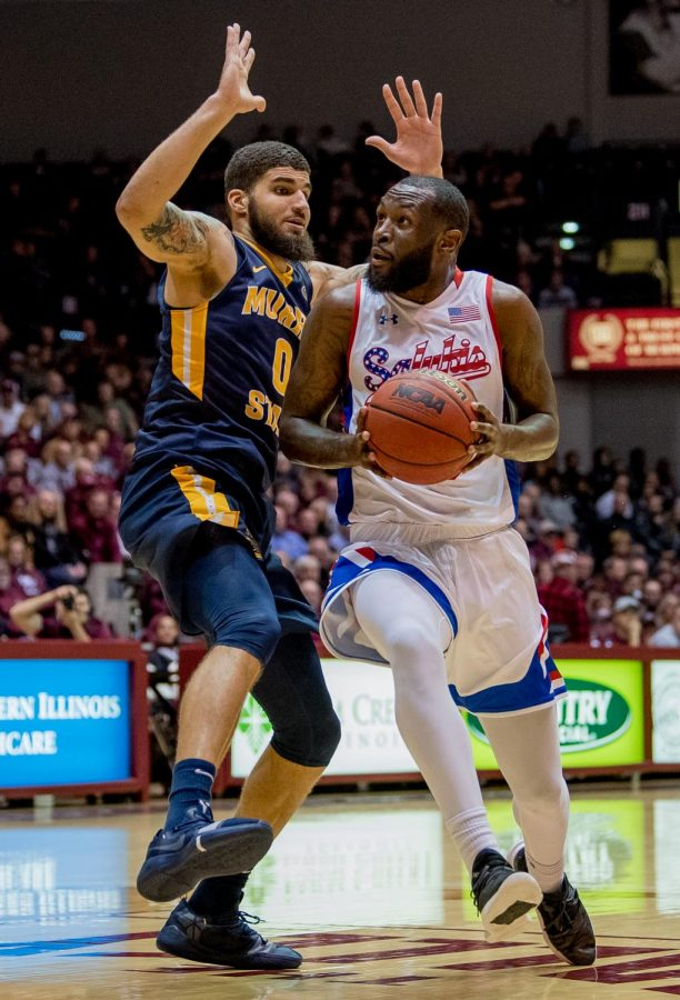 Southern Illinois senior guard Sean Lloyd Jr. attempts to push past Murray State Racers forward Mike Davis on Wednesday, December 12, 2018 during the first half of the Salukis matchup against the Murray State Racers.