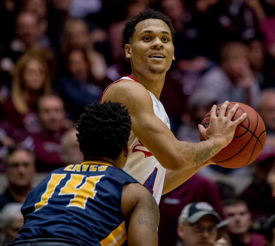 Southern Illinois junior guard Eric McGill looks for a team mate to pass the ball to on Wednesday, December 12, 2018 during the first half of the Salukis matchup against the Murray State Racers.