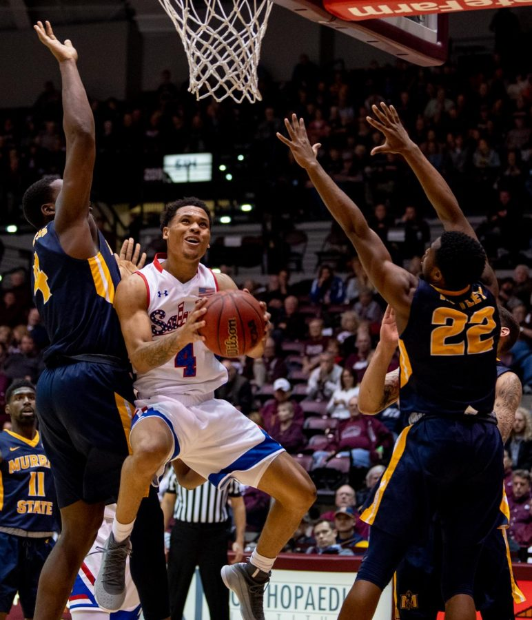 Southern Illinois junior guard Eric McGill attempts to go for a basket while under Racer pressure on Wednesday, December 12, 2018 during the second half of the Salukis matchup against the Murray State Racers.