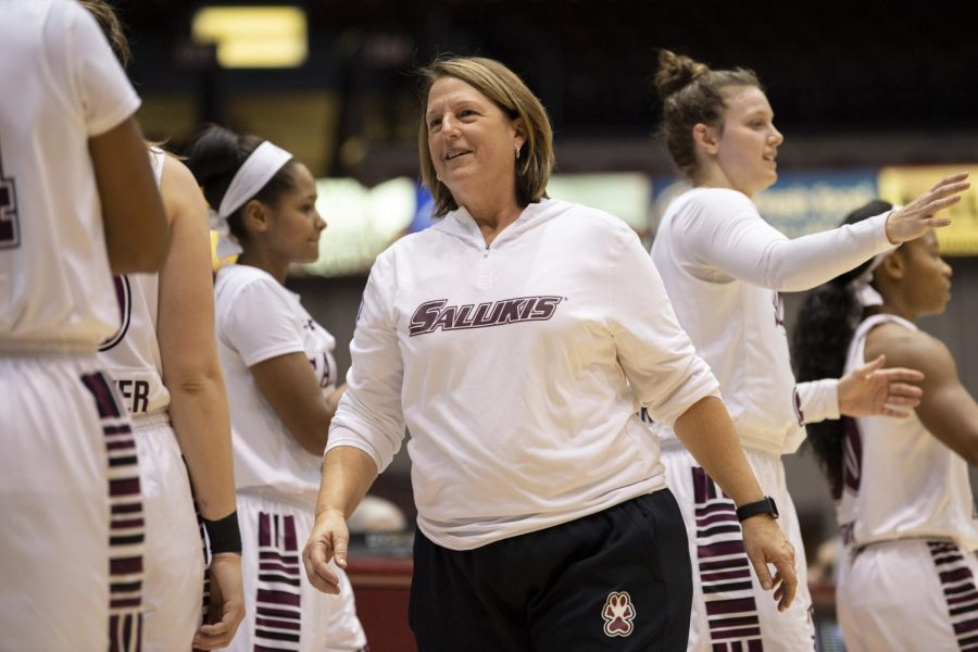 Coach+Cindy+Stein+smiles+among+her+players+on+Friday%2C+Jan.+4%2C+2019%2C+after+the+Salukis%27+47-64+win+against+the+Evansville+Purple+Aces+at+SIU+Arena.+