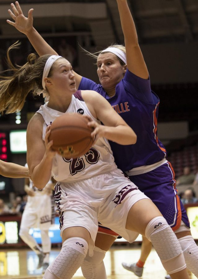 Sophomore forward Abby Brockmeyer tries to break through the Aces' defense on Friday, Jan. 4, 2019, during the Salukis' 47-64 win against the Evansville Purple Aces at SIU Arena.