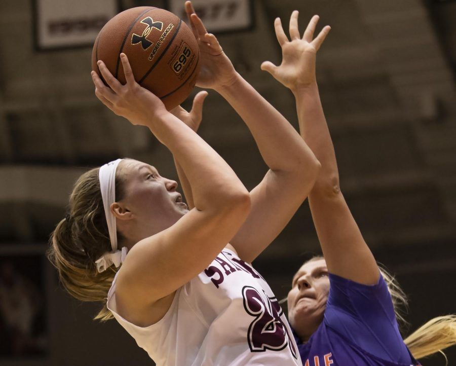 Sophomore forward Abby Brockmeyer goes for the basket on Friday, Jan. 4, 2019, during the Salukis' 47-64 win against the Evansville Purple Aces at SIU Arena.
