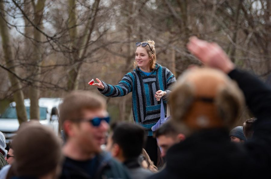 Alison Oakes, a fifth year senior majoring in electrical engineering at SIU, throws a jello shot into the crowd during a Polar Bear gathering on Saturday, Jan 26, 2019, on West Main Street in Carbondale. Oakes arrived at the party at noon and plans to stay at the party.