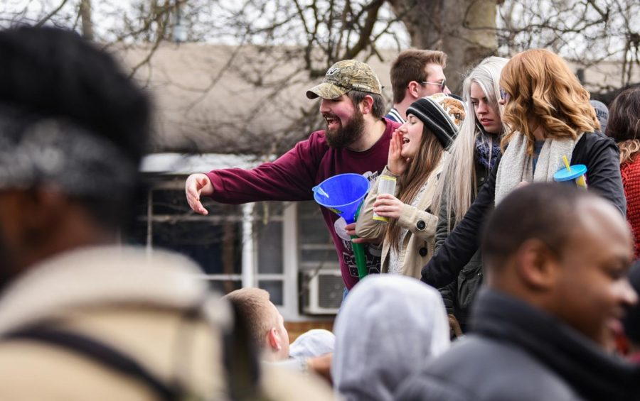 Partygoers yell to the crowd during a Polar Bear gathering on Saturday, Jan 26, 2019, on West Main Street in Carbondale.