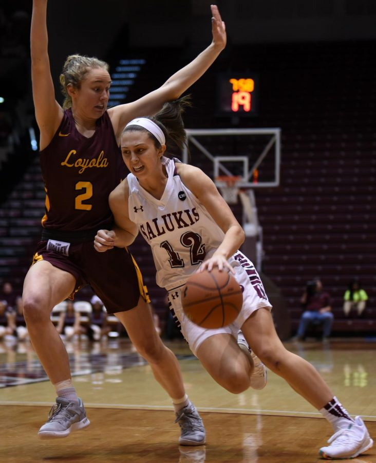 Southern Illinois Salukis guard Makenzie Silvey advances the ball on Sunday, Jan. 27, 2019, during the Southern Illinois Salukis' 74-63 win over the Loyola Ramblers at SIU Arena.