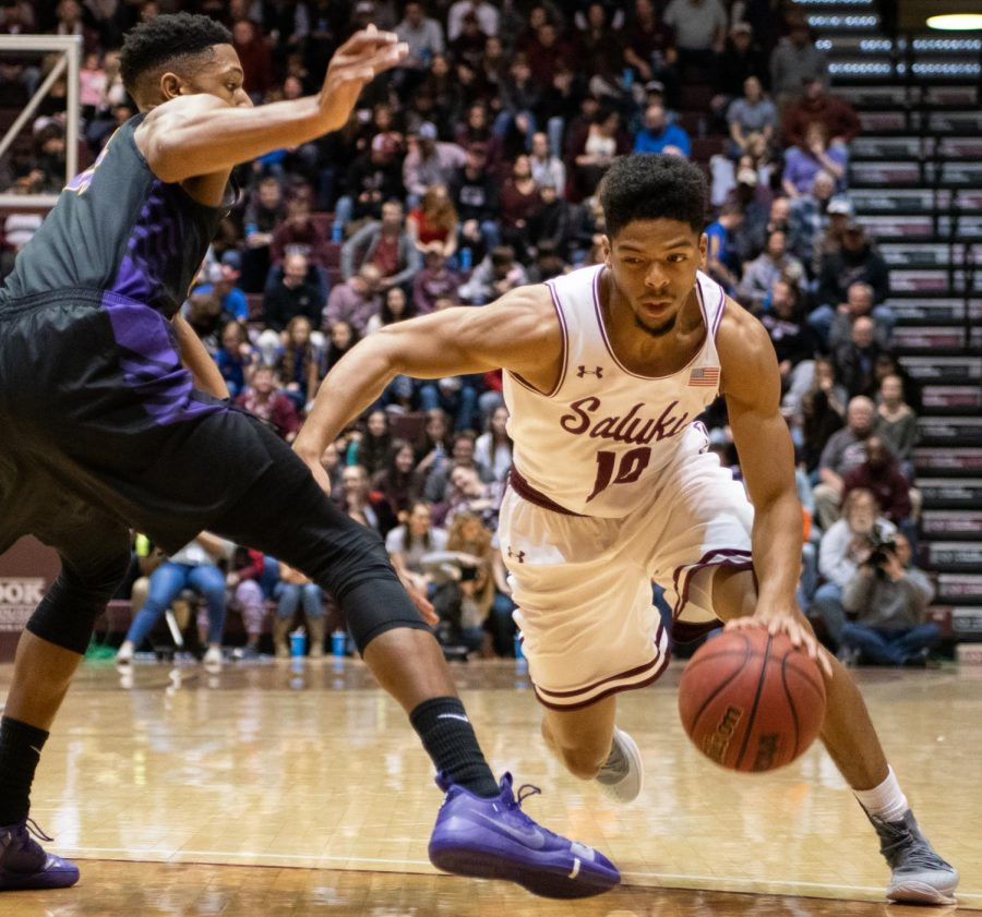Junior guard Aaron Cook advances the ball on Wednesday, Jan. 23, 2019 during the Salukis' 70-62 win over the Northern Iowa Panthers at SIU Arena.