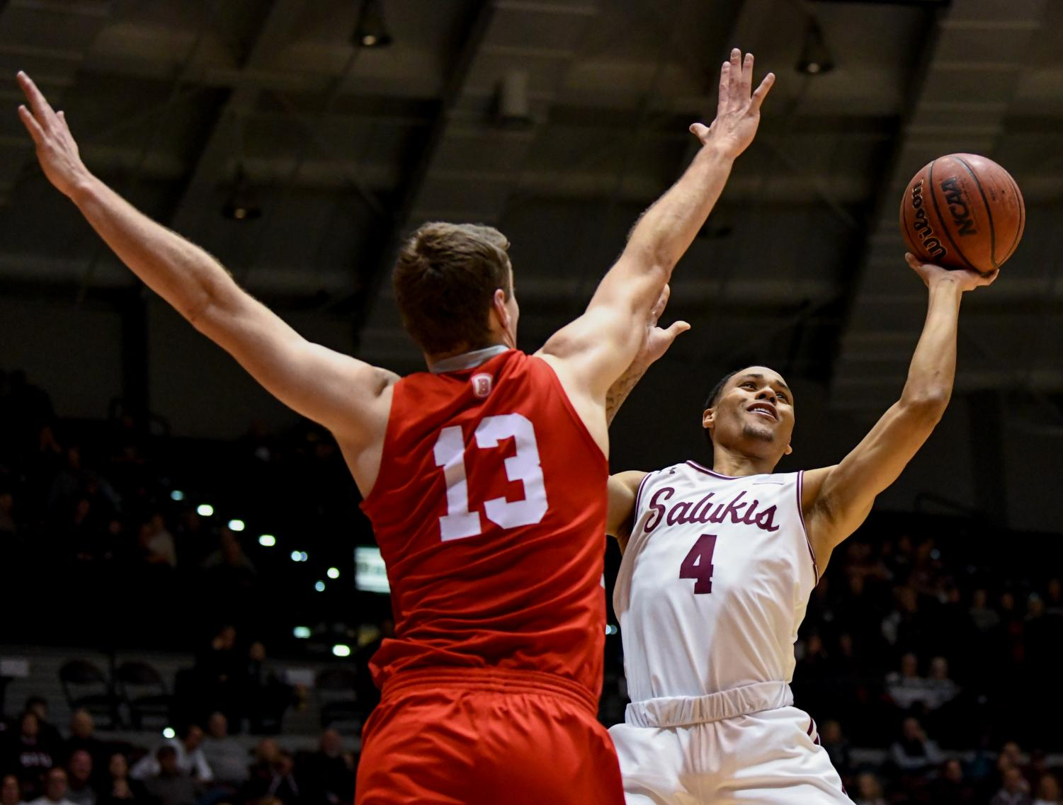 Southern Illinois Salukis guard Eric McGill attempts to get the ball past Bradley Braves forward Luuk van Bree on Sunday, Jan. 20, 2019, during the Bradley Braves 57-54 win over the Southern Illinois Salukis at SIU Arena.
