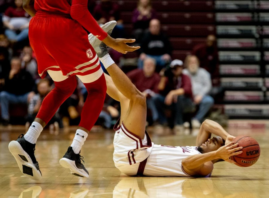 Southern Illinois Salukis guard Aaron Cook attempts to keep possession of the ball after being knocked over on Sunday, Jan. 20, 2019, during the Bradley Braves 57-54 win over the Southern Illinois Salukis at SIU Arena.