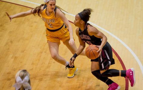 Southern Illinois Salukis guard Brittney Patrick drives the ball past Valparaiso Crusaders guard Meredith Hamlet on Friday, Jan. 25, 2019, during the Southern Illinois Salukis' 87-65 win over the Valparaiso Crusaders at SIU Arena.
