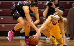 Southern Illinois Salukis guard Makenzie Silvey and Valparaiso Crusaders guard/forward Grace Hales fight for a loose ball on Friday, Jan. 25, 2019, during the Southern Illinois Salukis' 87-65 win over the Valparaiso Crusaders at SIU Arena.