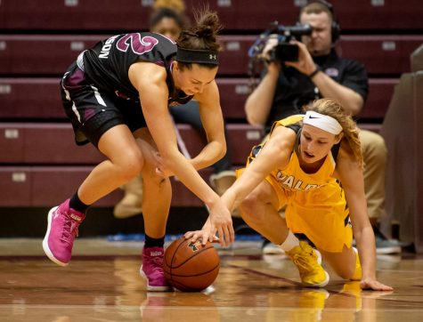 Southern Illinois Salukis guard Makenzie Silvey and Valparaiso Crusaders guard/forward Grace Hales fight for a loose ball on Friday, Jan. 25, 2019, during the Southern Illinois Salukis