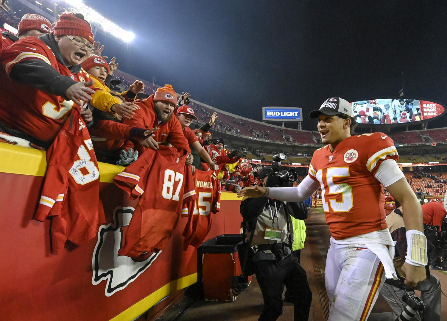 Kansas City Chiefs quarterback Patrick Mahomes greets fans as he heads to the locker room after the Chiefs defeated the Oakland Raiders 35-3 on Sunday, Dec. 30, 2018 at Arrowhead Stadium in Kansas City, Mo.