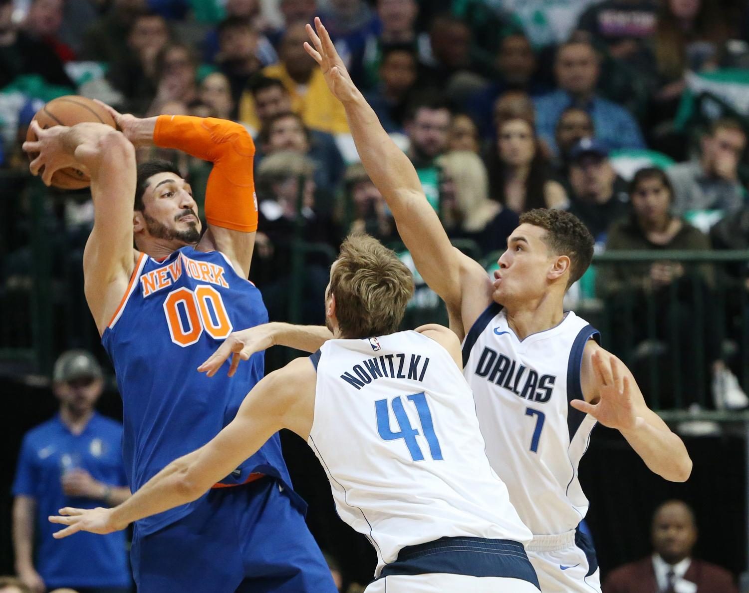 Dallas Mavericks forward Dirk Nowitzki (41) and forward Dwight Powell (7) defend against New York Knicks center Enes Kanter (00) during the first half on Sunday, January 7, 2018 at the American Airlines Center in Dallas, Texas.