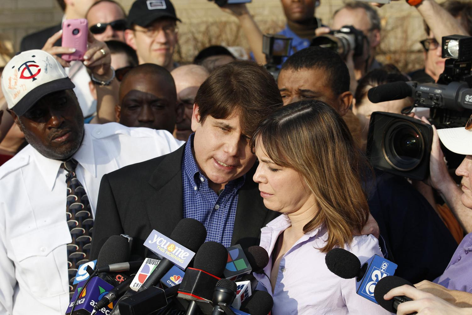 Former Illinois Gov. Rod Blagojevich delivers a statement with his wife, Patti, at his side, on his last full day of freedom at his home on Wednesday, March 14, 2012 in Chicago, Ill.