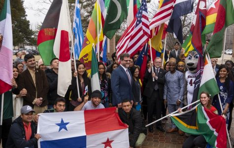 International students pose alongside Executive Director of International Affairs Andrew Carver, and SIU Chancellor John Dunn, on Monday, Feb. 4, 2019, during the International Parade of Flags on SIU's campus.