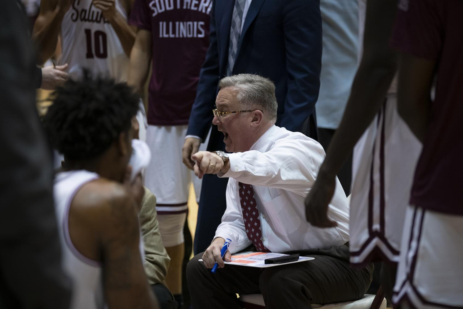 Saluki+Head+Coach+Barry+Hinson+addresses+the+team+during+a+time+out+on+Tuesday%2C+Feb.+12%2C+2019%2C+during+the+Saluki%E2%80%99s+72-69+loss+against+the+Drake+Bulldogs+at+the+SIU+Arena.+