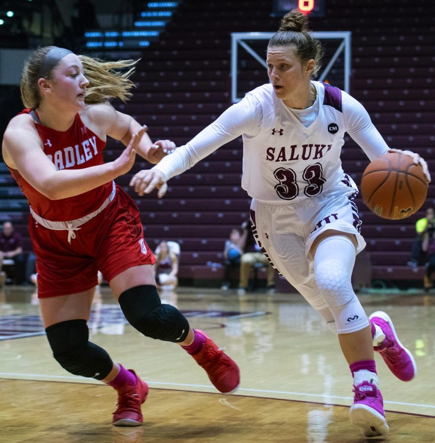 Saluki sophomore forward Rachel Pudlowski defends the ball on Friday, Feb. 15, 2019, during the Salukis 62-55 win against the Bradley Braves in the SIU Arena.