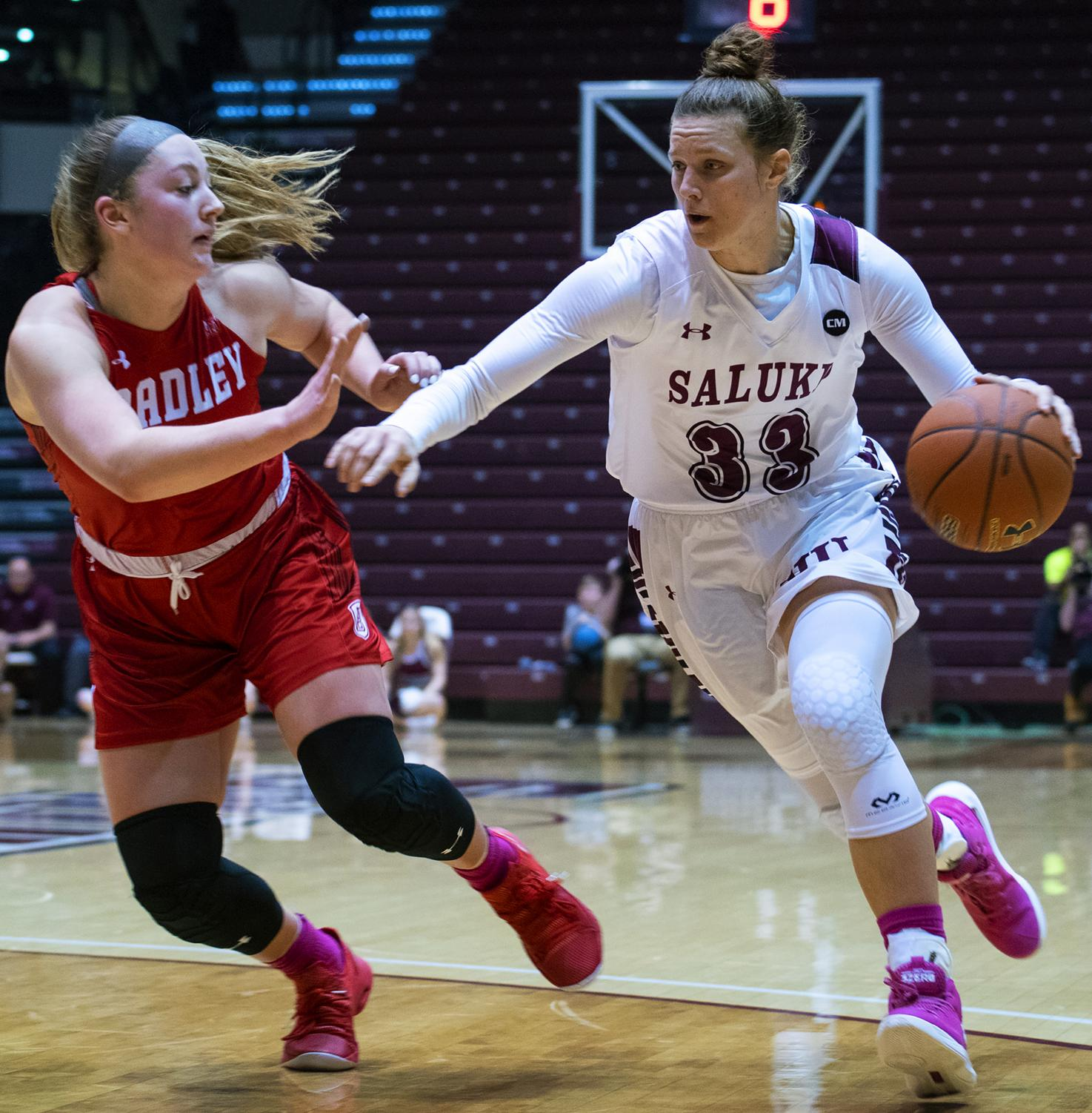 Saluki+sophomore+forward+Rachel+Pudlowski+defends+the+ball+on+Friday%2C+Feb.+15%2C+2019%2C+during+the+Salukis+62-55+win+against+the+Bradley+Braves+in+the+SIU+Arena.+