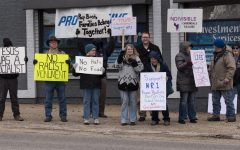 Indivisible Carbondale protests wall, calls on Mike Bost to support HR 1 proposal