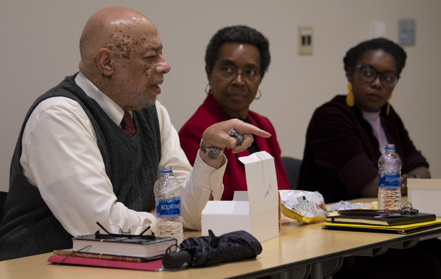 Reverend Joseph A. Brown, speaks about diversity and issues within SIU alongside Carolin Harvey, Seyi Amosu, on Wednesday, Feb. 20, 2019, inside the Student Services Building at SIU.