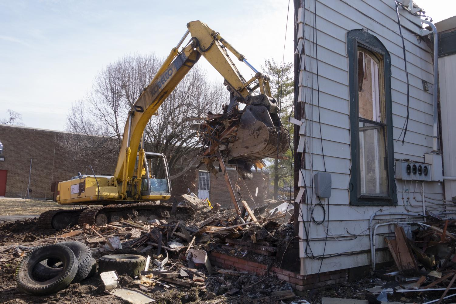 Kevin Wheetley, owner of The Wheetley Company, operates a track hoe on Feb. 21, 2019. Wheetley removes the remains of an apartment building that burnt down in November 2018.
