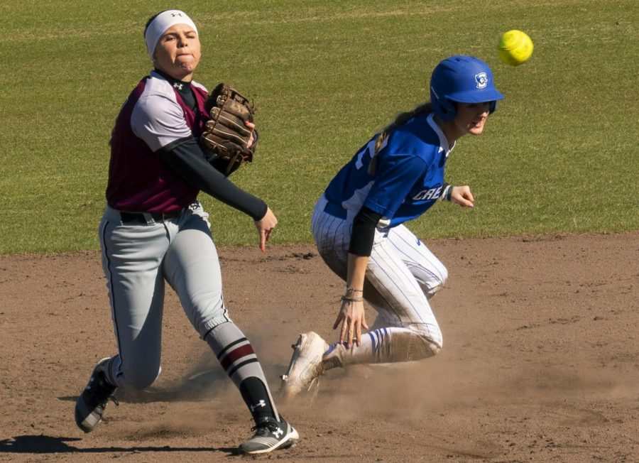 Saluki junior infielder Maddy Vermejan, of Lemont, tags second and throws to first base on Sunday, Feb. 24, 2019, during the Salukis' 2-1 loss to Creighton at Charlotte West Stadium.