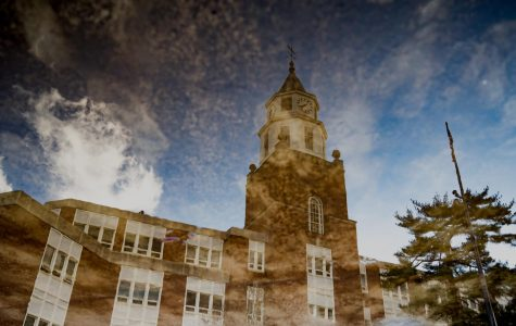 Pulliam Hall is reflected in a puddle on Wednesday, Feb. 20, 2019, outside of Pulliam Hall in Carbondale, Illinois.