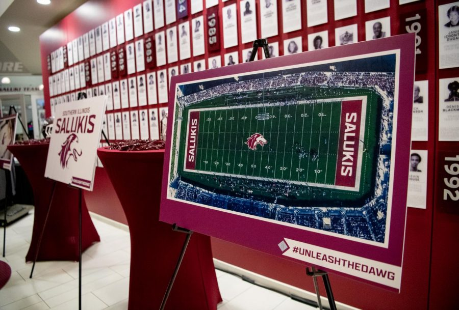 A+rendition+of+Saluki+Stadium+with+the+new+athletics+branding+is+displayed+on+Thursday%2C+Feb.+28%2C+2019%2C+during+the+logo-reveal+ceremony+at+SIU+Arena+in+Carbondale%2C+Illinois.+